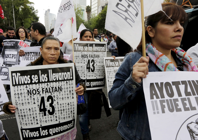 Relatives take part in a march calling for justice for 43 missing students, on the six-month anniversary of their disappearance, in Mexico City, March 26, 2015. (Reuters/Henry Romero)