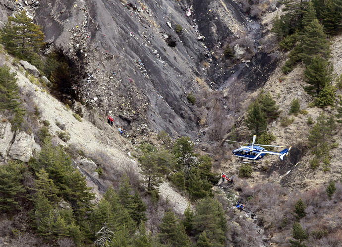 A French gendarme helicopter flies over the moutainside crash site of an Airbus A320, near Seyne-les-Alpes, March 25, 2015. (Reuters/Emmanuel Foudrot)