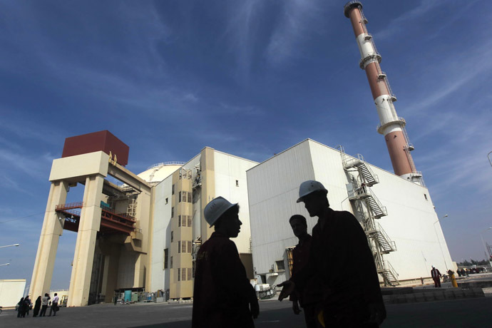 Iranian workers stand in front of the Bushehr nuclear power plant. (Reuters/Majid Asgaripour)