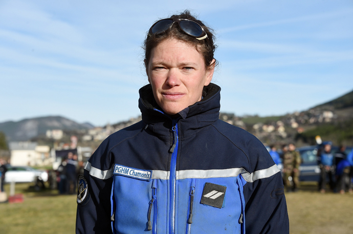 Alice Coldefy, a French gendarme from the PGHM (Gendarmerie High Mountain Rescue Squad), poses in Seyne-Les-Alpes near the crash site of the German Airbus A320 of the low-cost carrier Germanwings on April 3, 2015. (AFP Photo / Pascal Guyot)