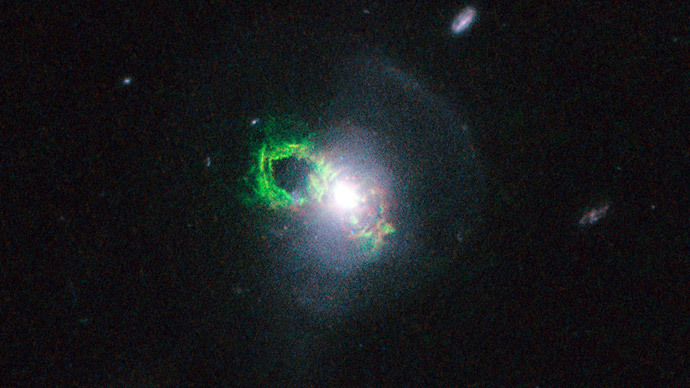 Hubble captures green 'quasar ghosts' from past radiation blast (PHOTOS)