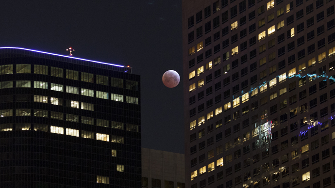 Shortest lunar eclipse of the century delights millions (PHOTOS)