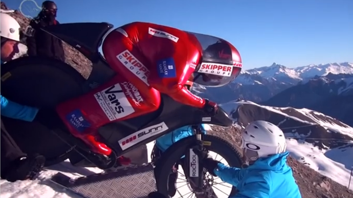 Extreme biker sets death-defying downhill world record on mountain of ice (VIDEO)