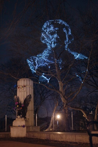 An image of Edward Snowden cast over where a sculpture of him stood earlier. (The Illuminator)