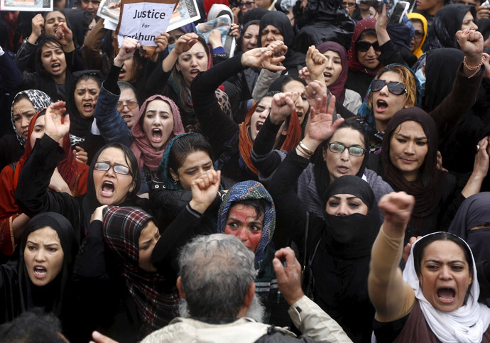 Members of civil society organizations chant slogans during a protest to condemn the killing of 27-year-old woman, Farkhunda, who was beaten with sticks and set on fire by a crowd of men in central Kabul in broad daylight on Thursday, in Kabul March 24, 2015. (Reuters/Omar Sobhani)