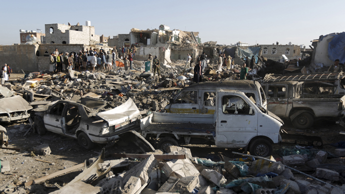 People gather at the site of an air strike at a residential area near Sanaa Airport (Reuters / Khaled Abdullah)