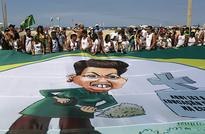 Demonstrators hold a banner with a drawing of Brazils President Dilma Rousseff during an anti-government demonstration in Copacabana in Rio de Janeiro, April 12, 2015 (Reuters / Pilar Olivares)