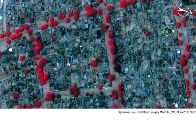 Imagery from 17 March 2015, shows extensive damage a neighbourhood that was intact on March 3. Red colour indicates healthy vegetation, while darker colors indicate burned areas.
