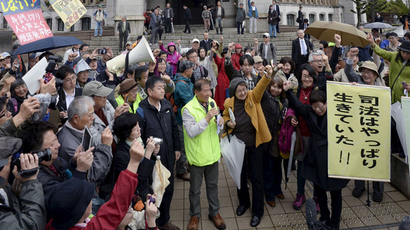 Local residents and their supporters celebrate after the Fukui District Court issued an injunction to prevent the restart of two nuclear reactors at Takahama nuclear power plant, in front of the court in Fukui, northwestern Japan, in this photo taken by Kyodo April 14, 2015.(Reuters / Kyodo)