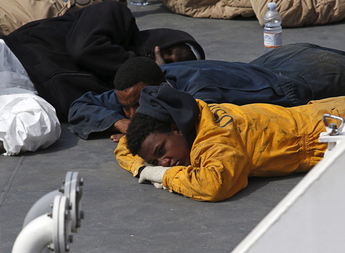 Surviving immigrants lie on the deck of the Italian coastguard ship Bruno Gregoretti in Senglea, in Valletta's Grand Harbour April 20, 2015. (Reuters/Darrin Zammit Lupi)