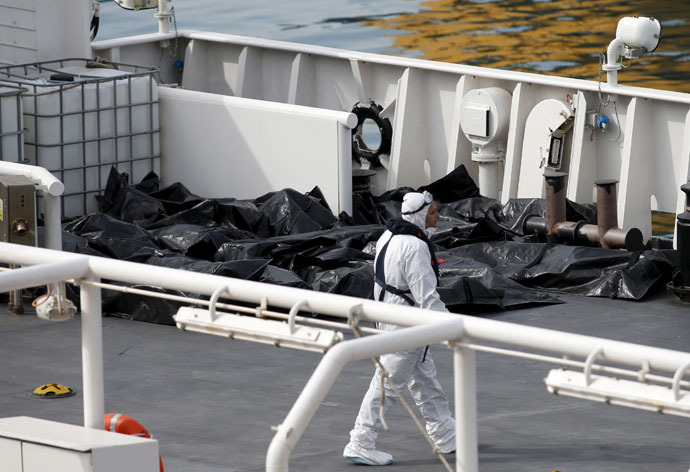 Bodies of dead immigrants lie on the deck of the Italian coastguard ship Bruno Gregoretti in Senglea, in Valletta's Grand Harbour April 20, 2015. (Reuters/Darrin Zammit Lupi)