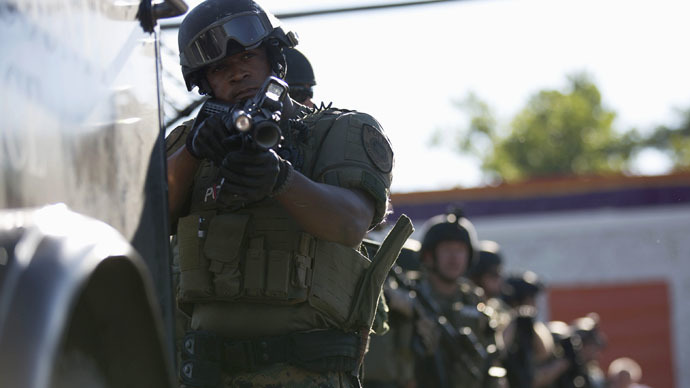 Standoffs in Ferguson, St. John, massive police presence
