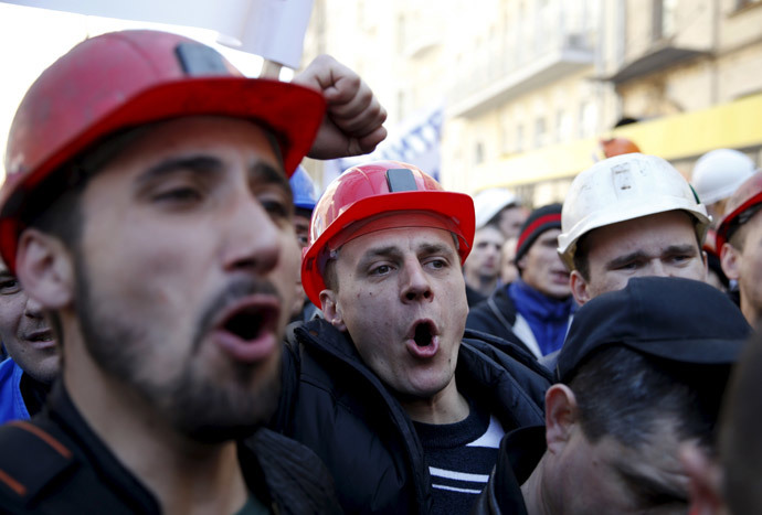 Miners shout slogans during a rally to demand the payment of their salaries from the government in central Kiev April 22, 2015. (Reuters / Valentyn Ogirenko)