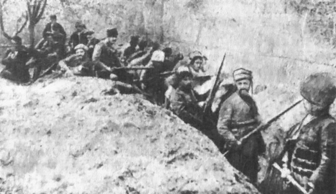 Armed Armenian civilians and self-defense units holding a line against Ottoman forces in the walled Siege of Van in May 1915. (Image from Wikipedia)