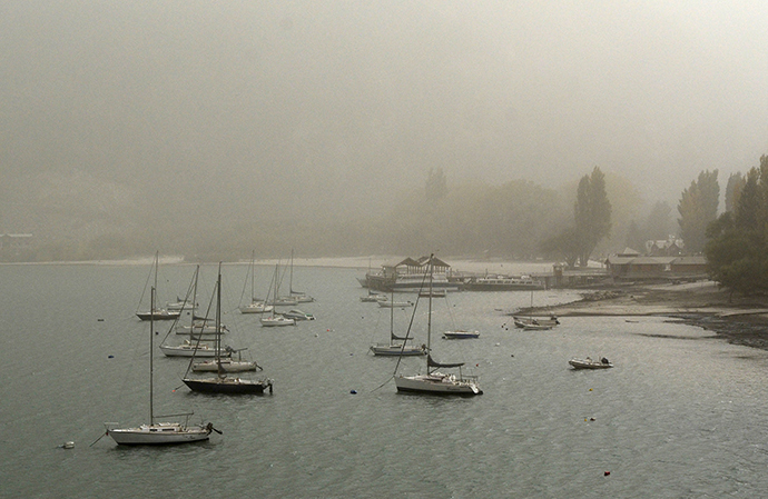 Boats are seen on the Lacar lake covered with ash from the Calbuco volcano in the Patagonian Argentine area of San Martin de Los Andes April 23, 2015 (Reuters / Patricio Rodriguez)