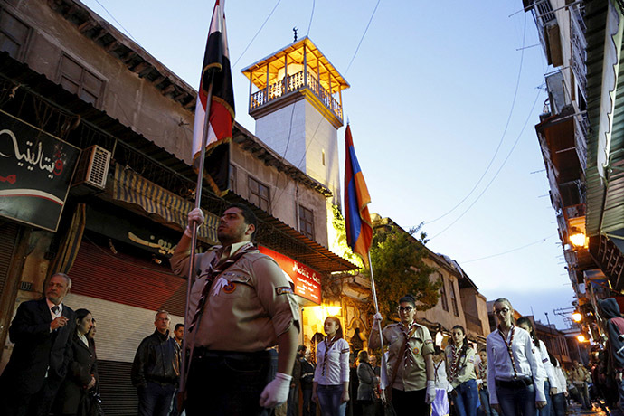 Syrian Armenian scouts carry a Syrian and an Armenian national flags as they march in the old city of Damascus, April 23, 2015, to mark the 100th anniversary of the mass killing of Armenians in the Ottoman Empire in 1915. Picture taken April 23, 2015. (Reuters/Omar Sanadiki)
