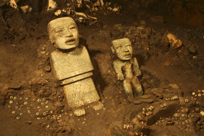Stone figurines are seen in a tunnel that may lead to a royal tombs discovered at the ancient city of Teotihuacan (Reuters / INAH / Handout via Reuters)