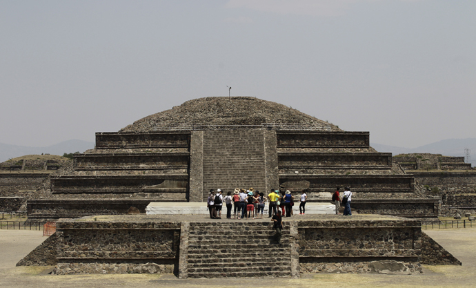 Visitors look on at the archaeological area of the Quetzalcoatl Temple near the Pyramid of the Sun at the Teotihuacan archaeological site, about 60 km (37 miles) north of Mexico City (Reuters / Henry Romero)