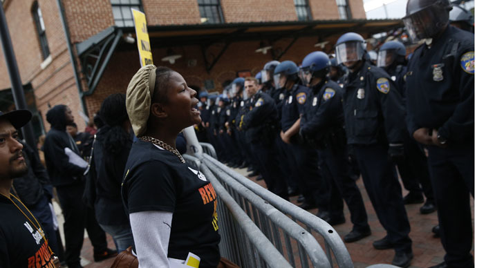 Unrest in Baltimore as thousands protest Freddie Gray's death