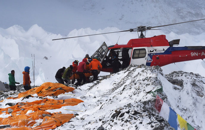 An injured person is loaded onto a rescue helicopter at Everest Base Camp on April 26, 2015, a day after an avalanche triggered by an earthquake devastated the camp. (AFP Photo/Roberto Schmidt)