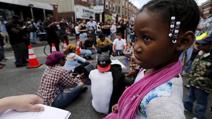Peaceful protesters gather in Baltimore ahead of curfew