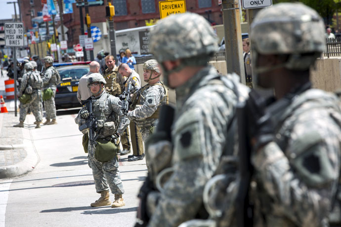National Guard troops stand watch along E. Pratt St. in Baltimore, Maryland April 28, 2015. (Reuters/Eric Thayer)