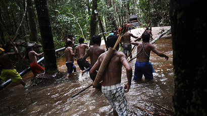 Munduruku Indian warriors approach a gold mine as they search for illegal gold mines and miners in their territory near the Caburua river, a tributary of the Tapajos and Amazon rivers in western Para (Reuters / Lunae Parracho)