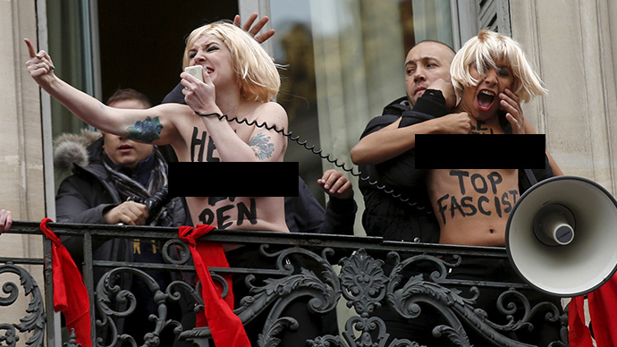 'Quite a paradox': Topless FEMEN activists attack Marine Le Pen at May Day rally (VIDEO)
