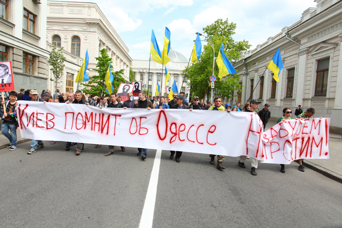 Demonstrators march in Kiev in memory of the victims of the 2014 Trade Unions House massacre.