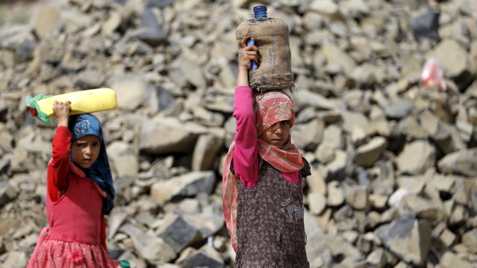 Girls carry jerrycans they filled with water from a public tap amid an acute shortage of water supply to houses in Sanaa (Reuters / Khaled Abdullah)