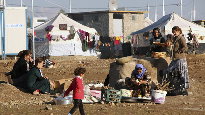 ISIS accused of mass-murdering 'hundreds' of Yazidi captives in Iraq