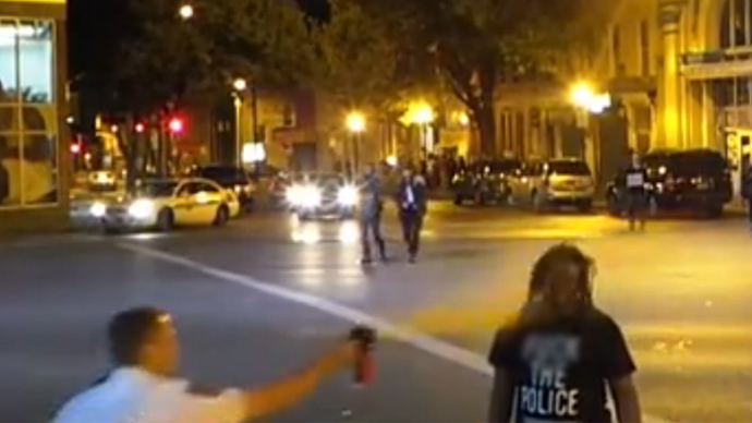 Baltimore protester wearing 'F**k the police T-shirt' gets face full of pepper spray (VIDEO)