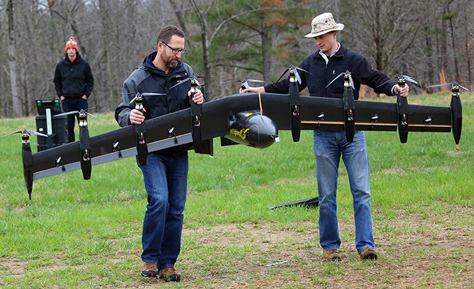 Engineers David North (L) and Bill Fredericks (R) carry the Greased Lightning before one of its flight tests (NASA Langley / David C. Bowman)