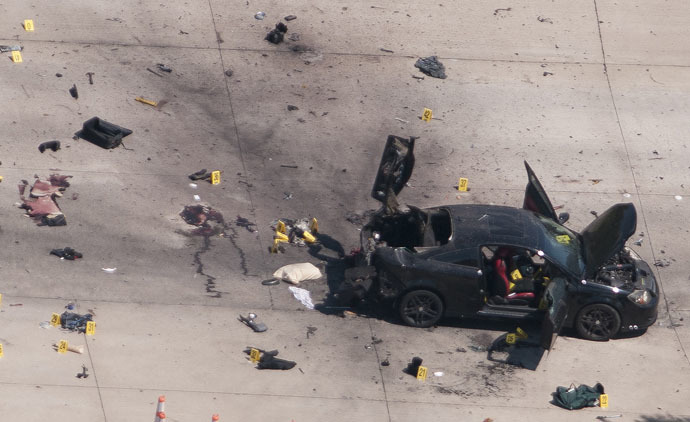 An aerial view shows the car that was used the previous night by two gunmen, who were killed by police, as it is investigated by local police and the FBI in Garland, Texas May 4, 2015. (Reuters/Rex Curry)