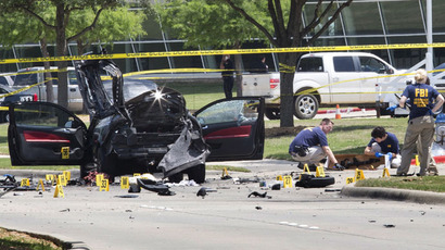 Local police and FBI investigators collect evidence, including a rifle, where two gunmen were shot dead after their bodies were removed in Garland, Texas May 4, 2015. (Reuters/Laura Buckman)