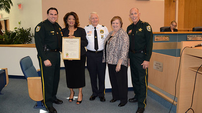 County Commissioner Priscilla Taylor (second from left) presents a proclamation declaring April 17, 2015 as Palm Beach Sheriff's Office (PBSO) Volunteer Day in Palm Beach County.(Photo from pbcgov.com)