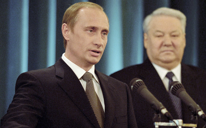 Vladimir Putin (left) taking the oath of President of the Russian Federation. Right: first Russian president Boris Yeltsin. (RIA Novosti/Vladimir Rodionov)