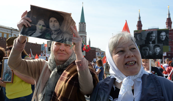 Participants during the march of the Immortal Regiment Moscow regional patriotic public organization on Red Square. (RIA Novosti/Iliya Pitalev)