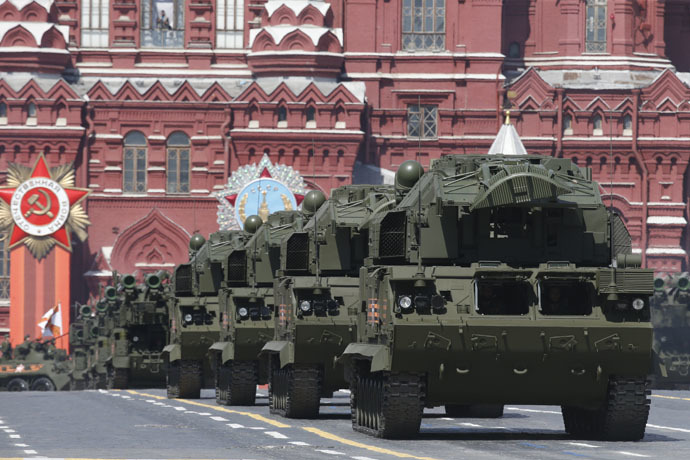 Russian TOR-M2U tactical surface-to-air missile systems drive during the Victory Day parade at Red Square in Moscow, Russia, May 9, 2015. (Reuters/Sergei Karpukhin)