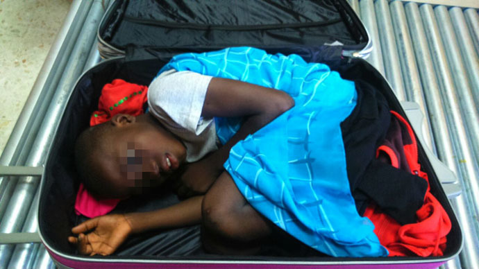A picture provided by Spanish Guardia Civil on May 8, 2015 shows an 8-year-old sub-Saharan boy hidden in a suitcase. (AFP Photo)