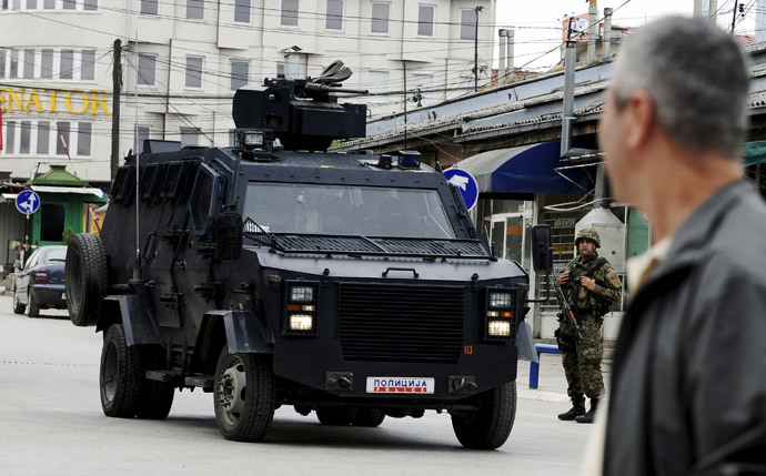 A Macedonian police armoured personnel carrier drives past premises in Kumanovo, north of the capital Skopje, Macedonia May 9, 2015.(Reuters / Ognen Teofilovski )
