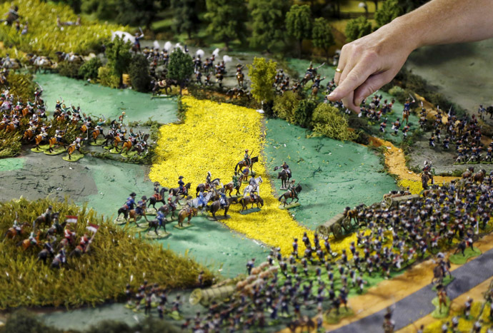 Waterloo enthusiast Willy Smout, 56, points at a figurine representing French Emperor Napoleon (C on white horse) on a 40-square-metre miniature model of the June 18, 1815 Waterloo battlefield, in Diest, Belgium, in this picture taken on April 29, 2015. (Reuters/Francois Lenoir)