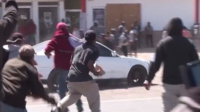 Dozens of protesting Mexican farm workers injured in clashes with police amid violent crackdown