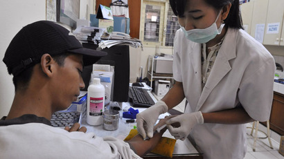 A medical technician takes a blood sample from a patient to check for dengue and typhoid at a government health center in Jakarta (AFP Photo)