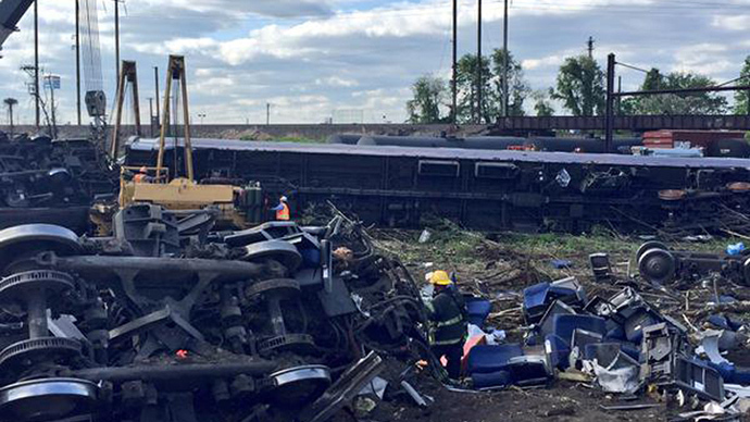Emergency personnel and members of the Philadelphia Fire Department investigate the scene of a train accident in Philadelphia, Pennsylvania, in this handout photo provided by the Philadelphia Fire Department, May 13, 2015. (Reuters/Philadelphia Fire Department/Handout)