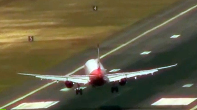 Blown away: Planes battle wild winds at one of world's most dangerous airports (VIDEO)