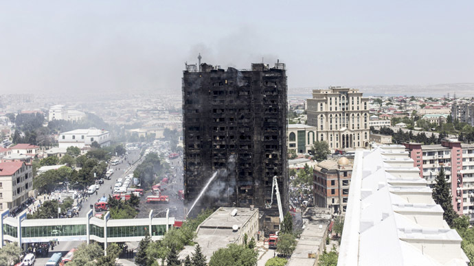 A burnt multi-storey residential building is seen in Baku, Azerbaijan, May 19, 2015. (Reuters/Ehtiram Jabi)