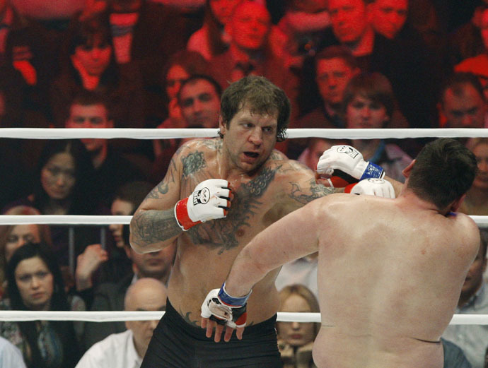 Russian Alexander Emelianenko (background) and Lithuanian Tadas Rimkyavichus (foreground) leads in the mixed martial arts M-1 Challenge 31 fight in St. Petereburg. (Reuters/Vadim Zhernov)