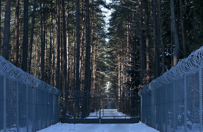 Barbed wire fence surrounding a military area is pictured in the forest near Stare Kiejkuty village, close to Szczytno in northeastern Poland. (Reuters/Kacper Pempel)