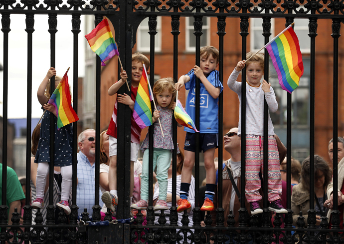 Children wave rainbow flags as they stand with their same-sex marriage supporting parents at Dublin Castle in Dublin, Ireland May 23, 2015. (Reuters / Cathal McNaughton)